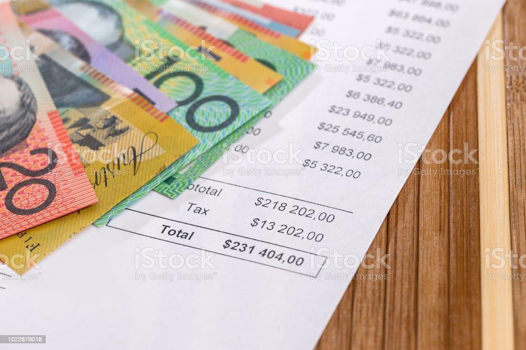 Australian dollars on purchasing order on wooden background stock photo