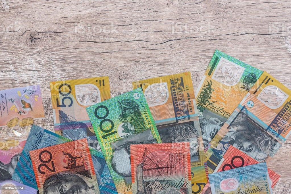 Australian dollars on wooden table as background stock photo