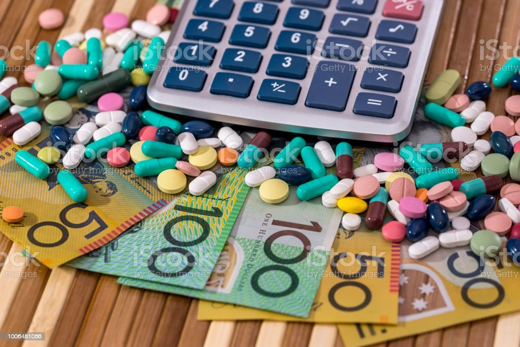 Australian dollars with colorful pills and calculator stock photo