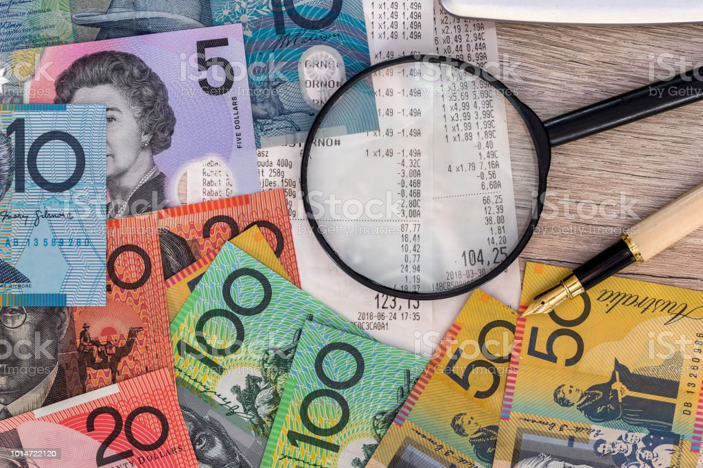 Australian dollars with receipt, calculator, pen and magnifier stock photo