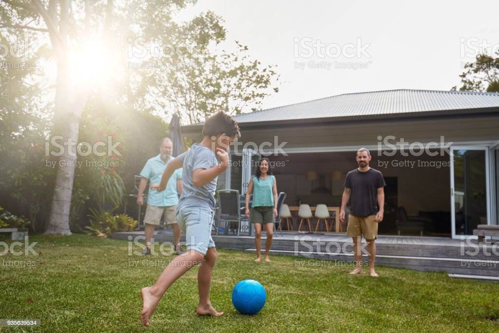 Australian family playing in the back yard garden stock photo