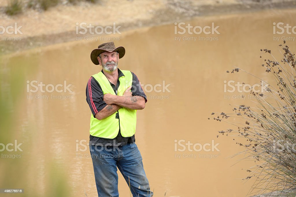 Australian Farmer by Water Reservoir stock photo