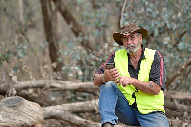 Australian Farmer using Mobile Phone stock photo