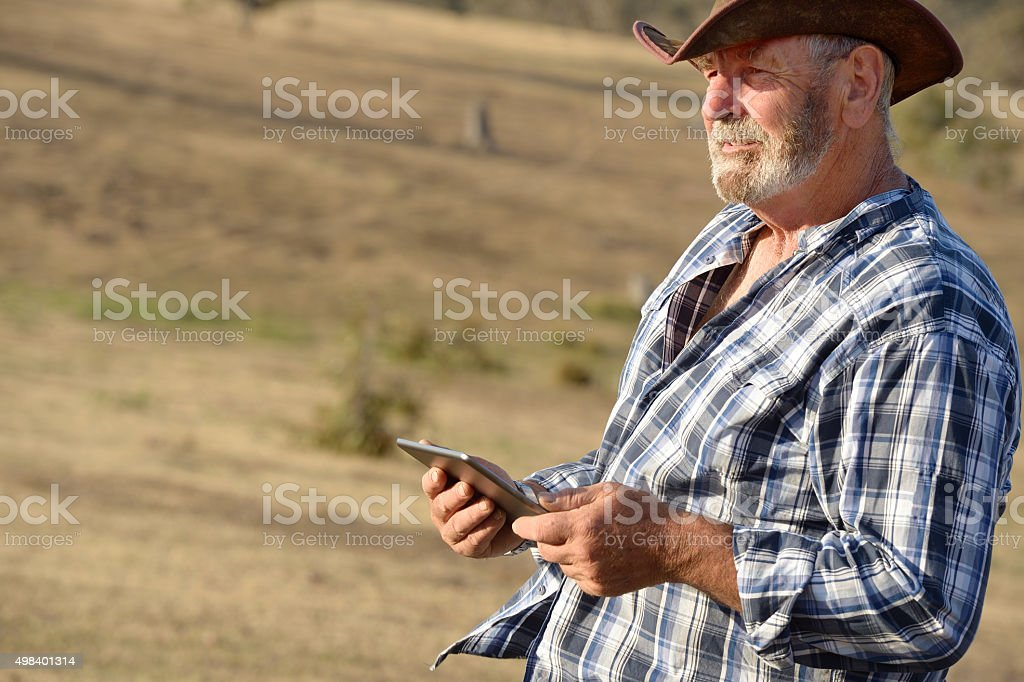 Australian Farmer using Tablet stock photo