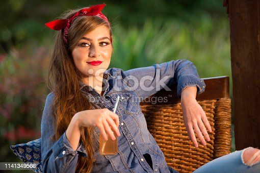Fresh and breezy model outdoors, makeup, beautiful eyelashes. Copy space, summer feel. Country road.