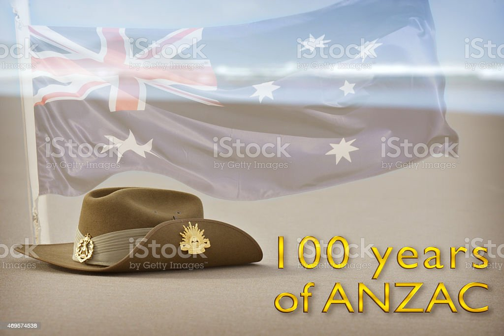 Australian flag and slouch hat on beach celebrating Anzac stock photo