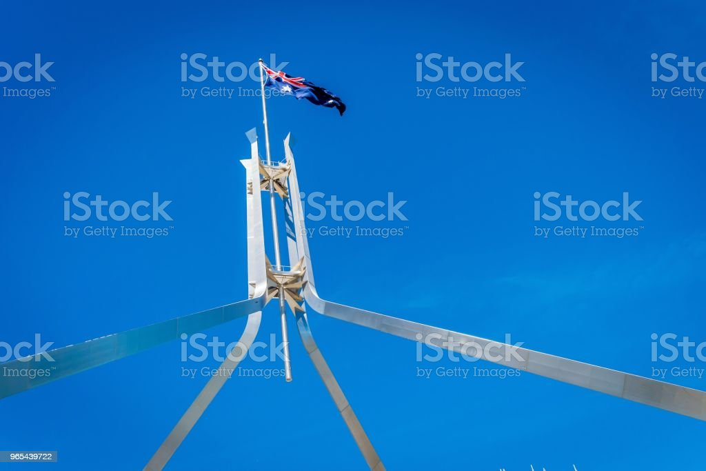 Australian flag flying on top of the Parliament House in Canberra zbiór zdjęć royalty-free