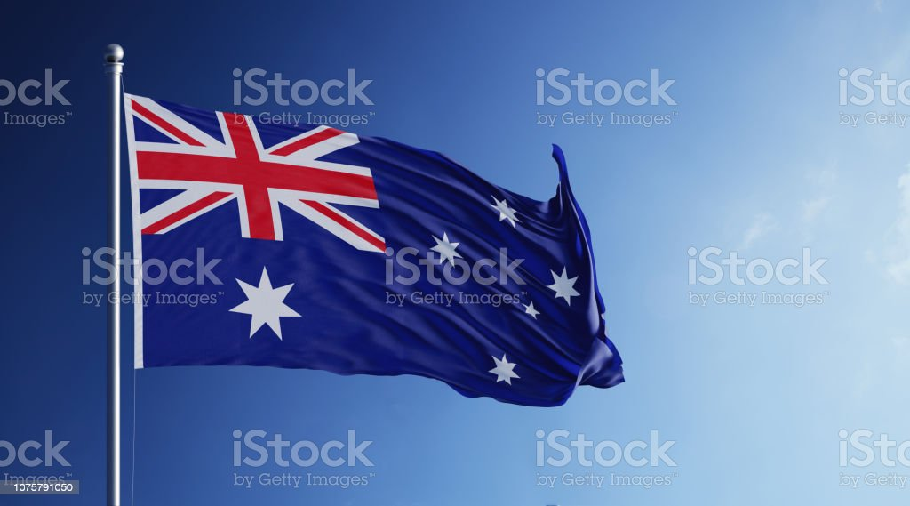 Australian Flag Waving With Wind On Blue Sky stock photo
