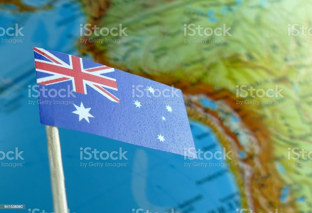 Australian flag with a globe map as a background macro stock photo