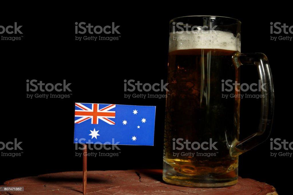 Australian flag with beer mug isolated on black background stock photo