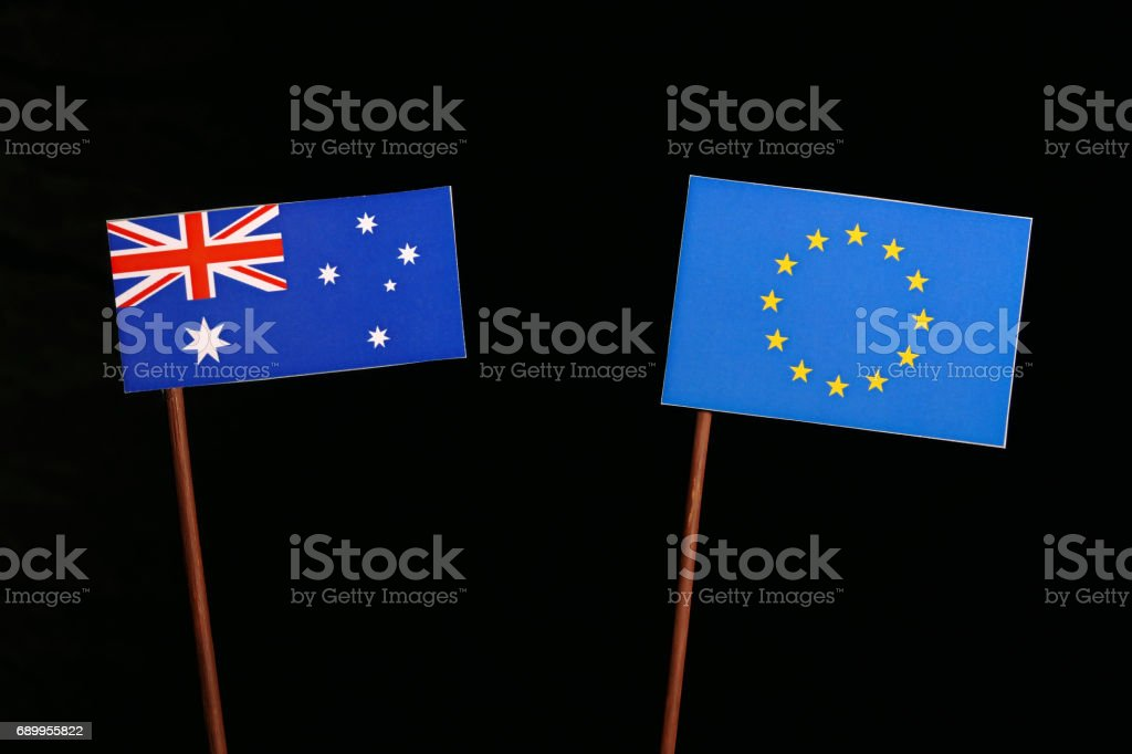 Australian flag with European Union (EU) flag isolated on black background stock photo