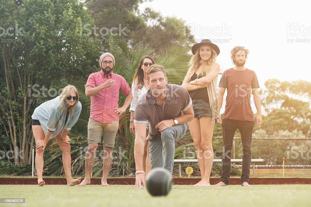 Australian Friends Enjoy Playing Lawn Bowling stock photo