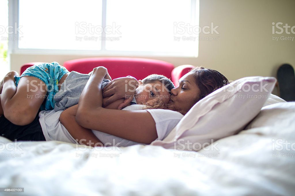 Australian Indigenous Aboriginal Mother and Son at home stock photo