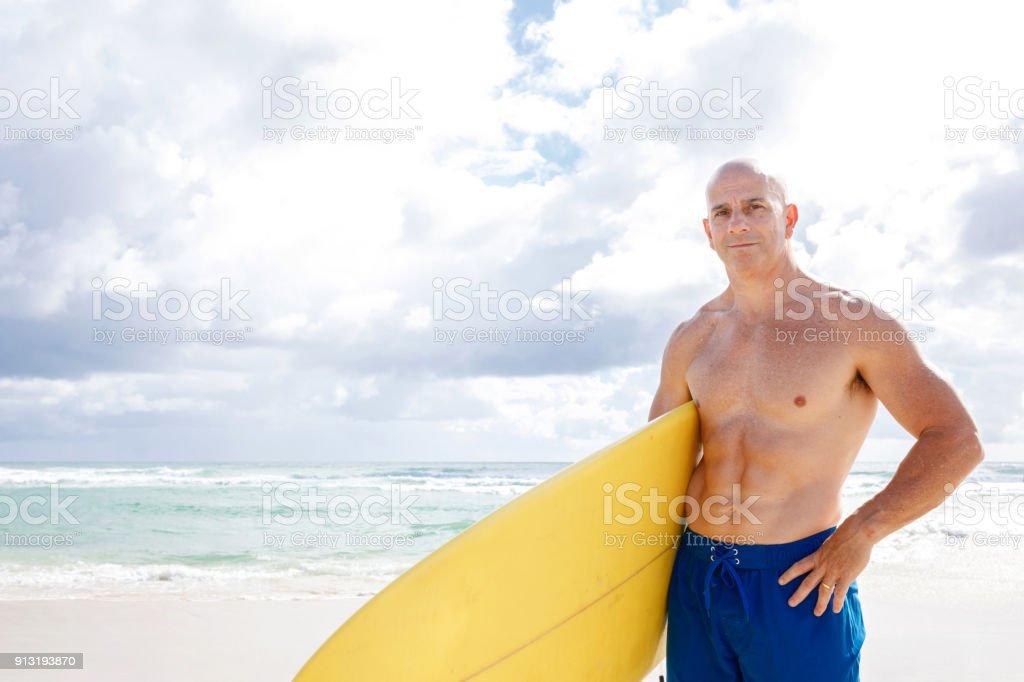 Australian Mature Age Man Going Surfing stock photo