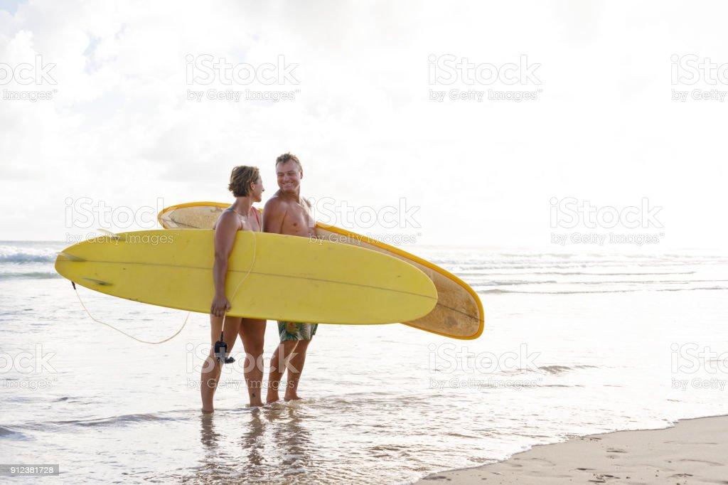Australian Mature Age Surfing Couple stock photo