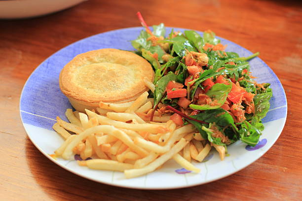 Australian Meat Pie Potato Chips and Salad stock photo