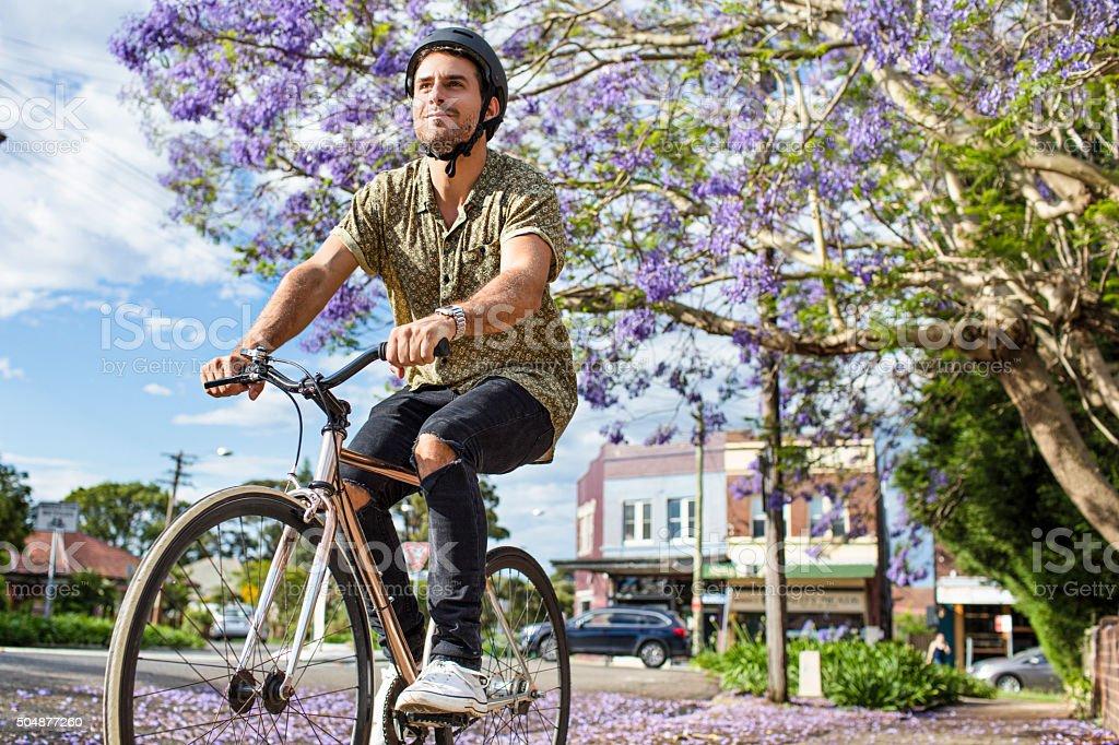 Australian mid adult man riding the bike stock photo