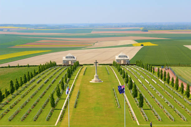 australian military cemetery at villers bretonneux in picardy, france memorial of the first world war at villers-bretonneux in somm, under sun and blue sky picardy stock pictures, royalty-free photos & images