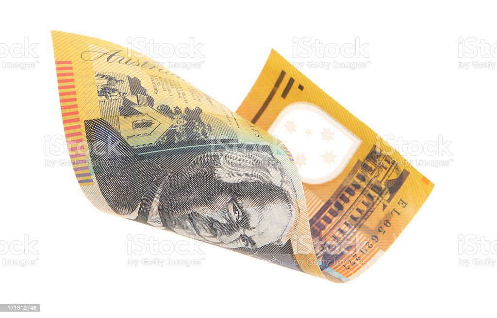 Australian money curled into loose roll on white background stock photo