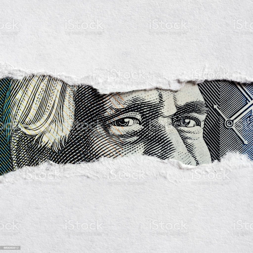Australian Money Face through Torn Paper stock photo