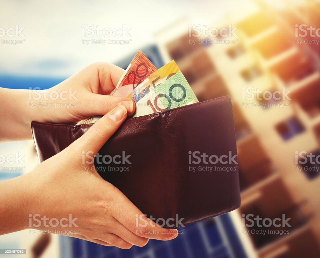 australian money in wallet on real estate background stock photo