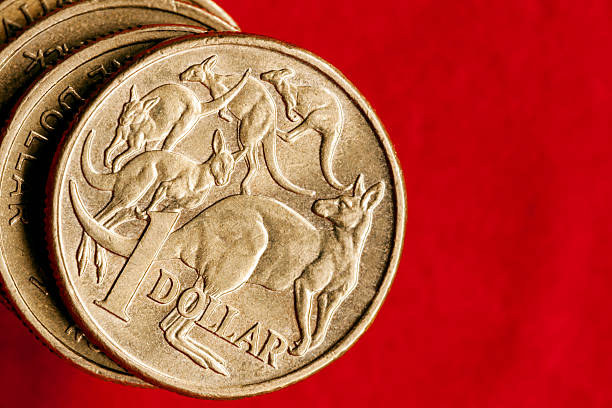 Australian Money One Dollar Coins over Red stock photo