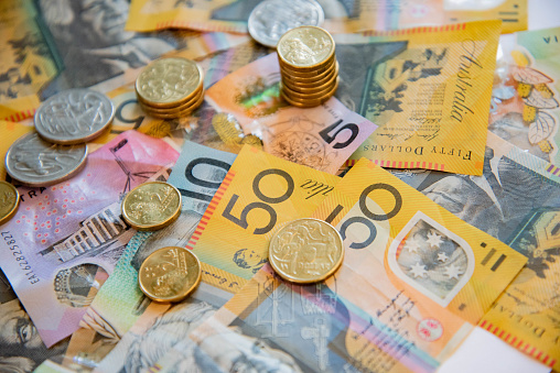 istock Australian notes and coins spilled out. 1208696917