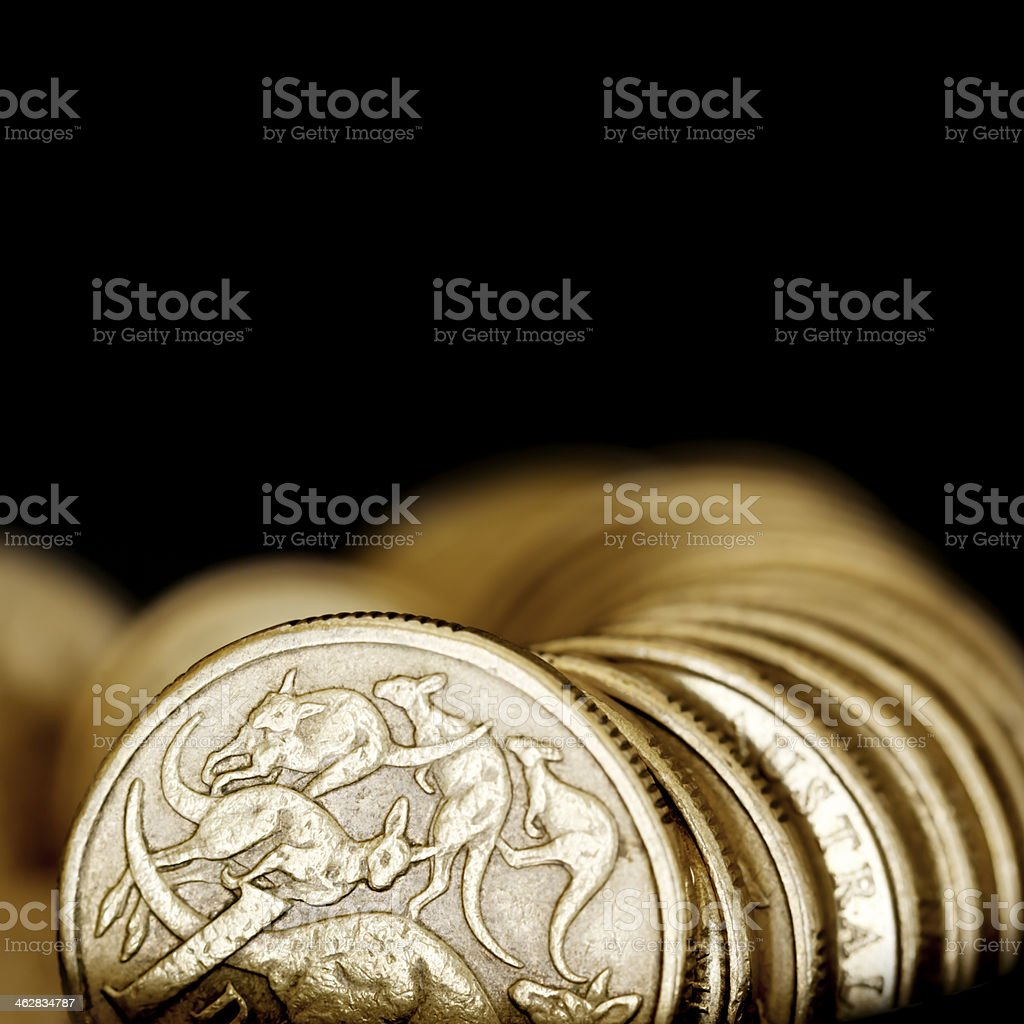 Australian One Dollar Coins over Black royalty-free stock photo
