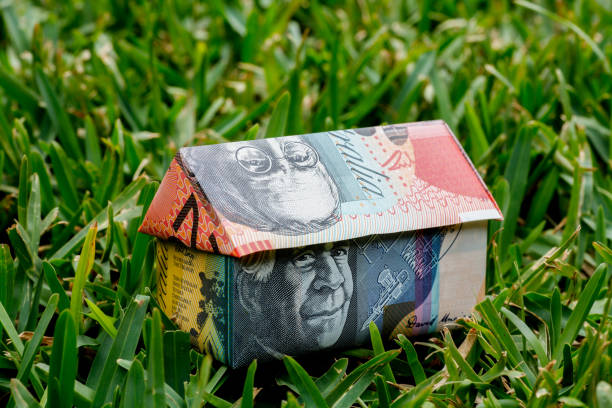 Australian Origami Money House Origami house made with Australian Note money sitting on grass lawn borrowing stock pictures, royalty-free photos & images