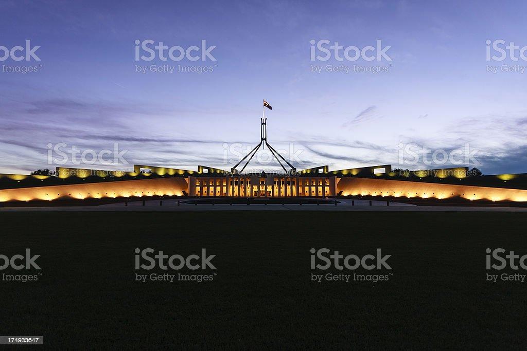 Australian Parliament House illuminated with dark blue sky stock photo