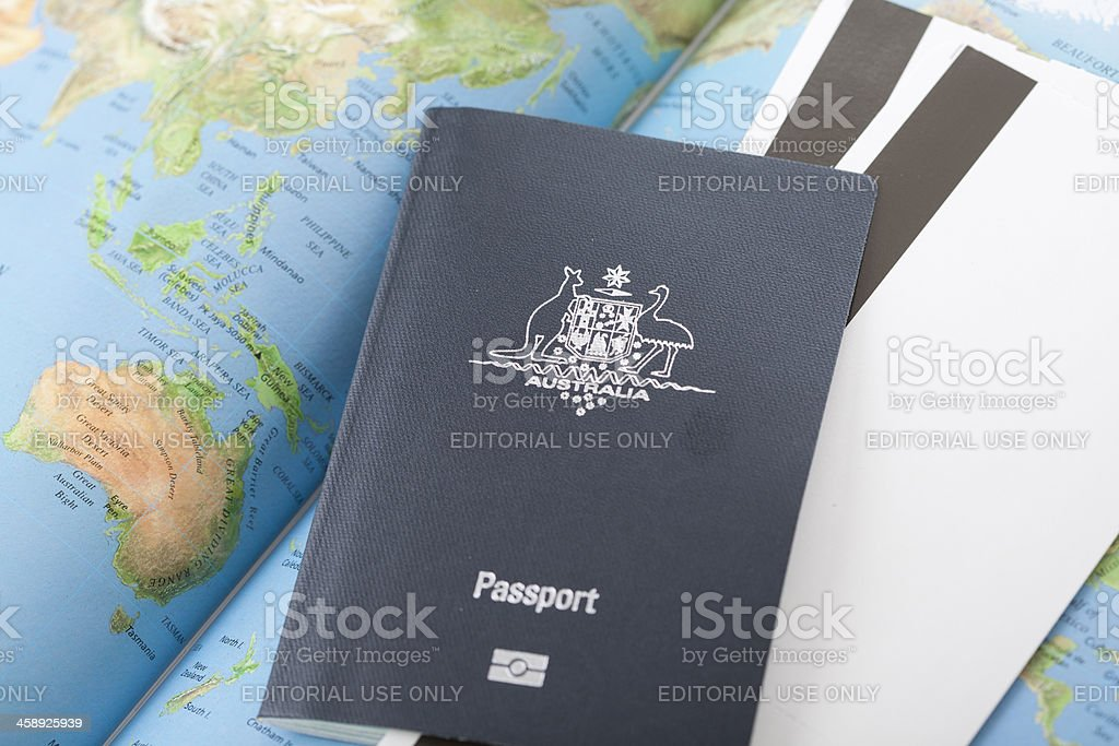 Australian Passport with Map of the World and Boarding Passes stock photo
