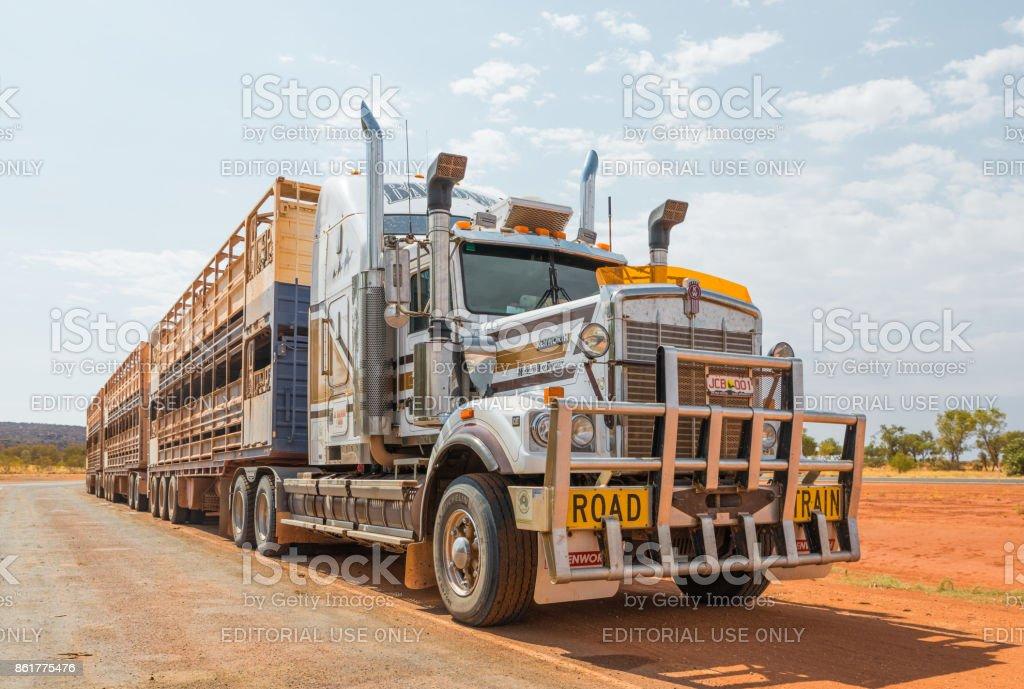 3 trailer Australian road train 3 trailer at truck stop along Stuart...
