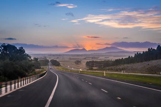 Australian road trip, motion blur highway landscape at dusk with mountain Ararat stock photo