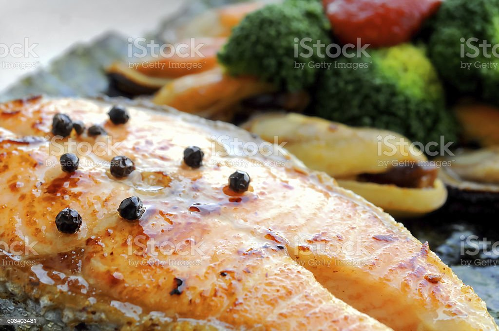 Australian salmon fillet steak grilled with New Zealand mussels stock photo