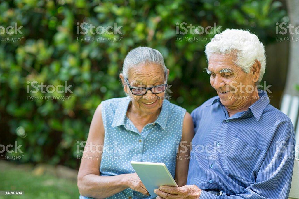 Australian senior couple with digital tablet stock photo