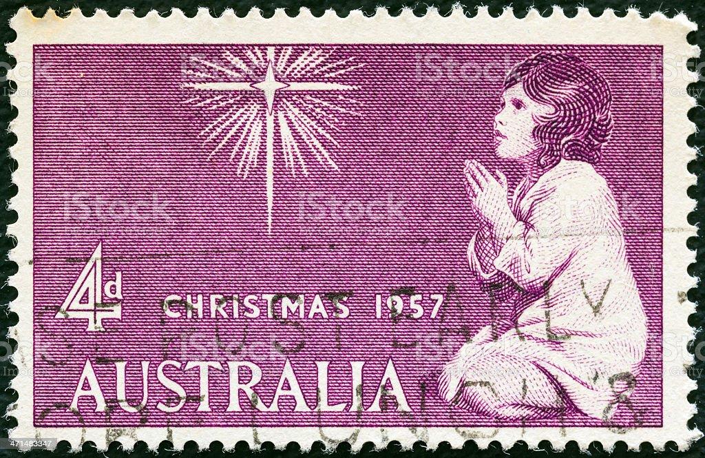 Australian stamp shows The Spirit of Christmas (Joshua Reynolds) (1957) stock photo