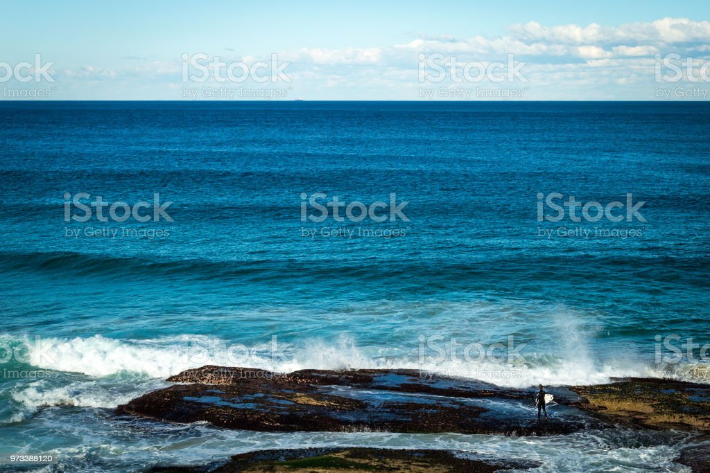 Australian surfer prepares to make his entry into the winter surf stock photo