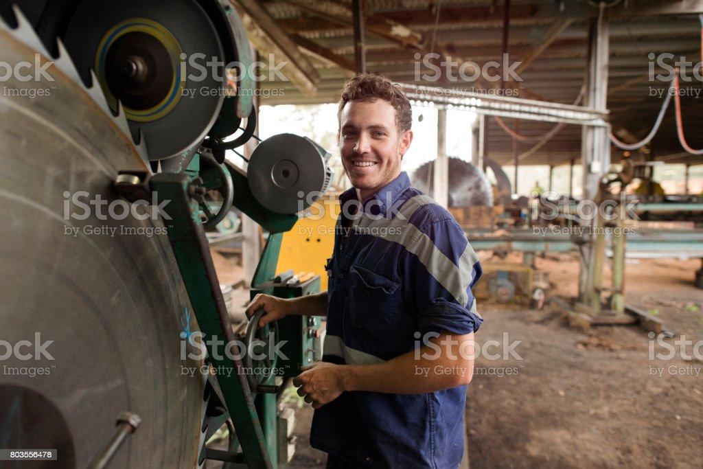 Australian tradesman using machinery equipment stock photo