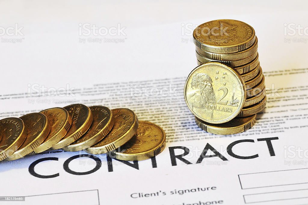 Australian two dollar coins sitting on a contract royalty-free stock photo