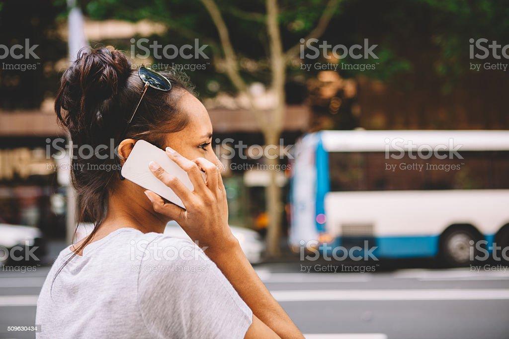 australian woman engaged on the phone stock photo