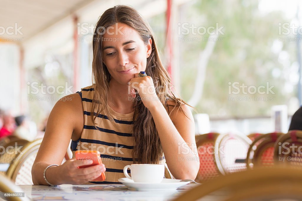 Australian woman texting stock photo