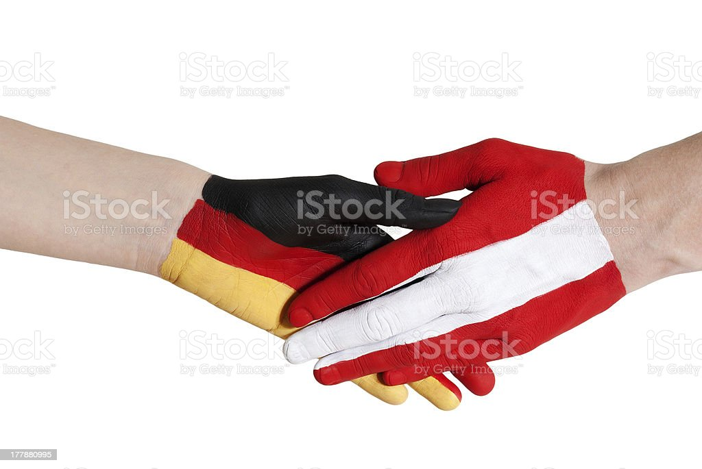 austria and germany shaking hands royalty-free stock photo