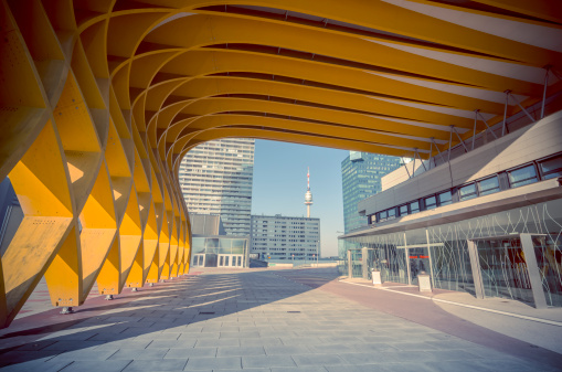 The Austria Center Vienna (ACV) - here the entrance - is Austria's largest convention center and is also one of Europe's most modern. It is used for conferences, exhibitions, corporate events and concerts. Skyscrapers in the background of the Danube and Danube tower can be seen.