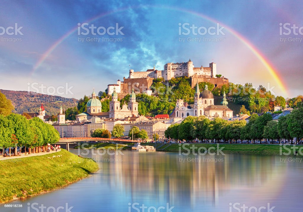 Austria, Rainbow over Salzburg castle stock photo