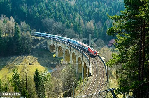 Semmering, Austria - March 22, 2014: Train on viaduct of Semmering railway - oldest mountain railway of Europe and UNESCO World Heritage site