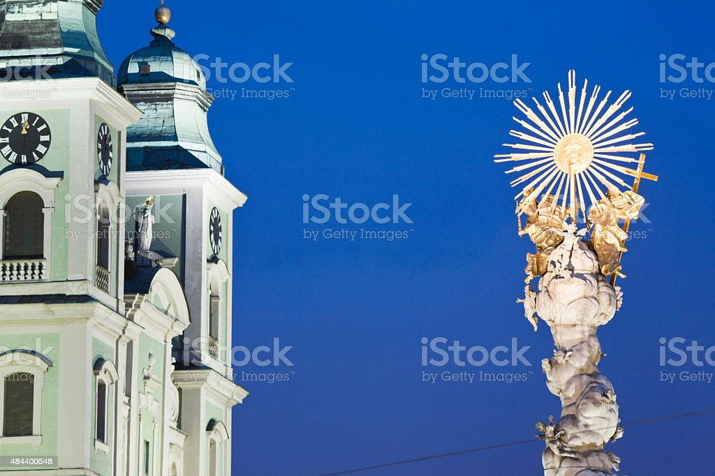 Austria,Linz,Old cathedral with Trinity Column stock photo