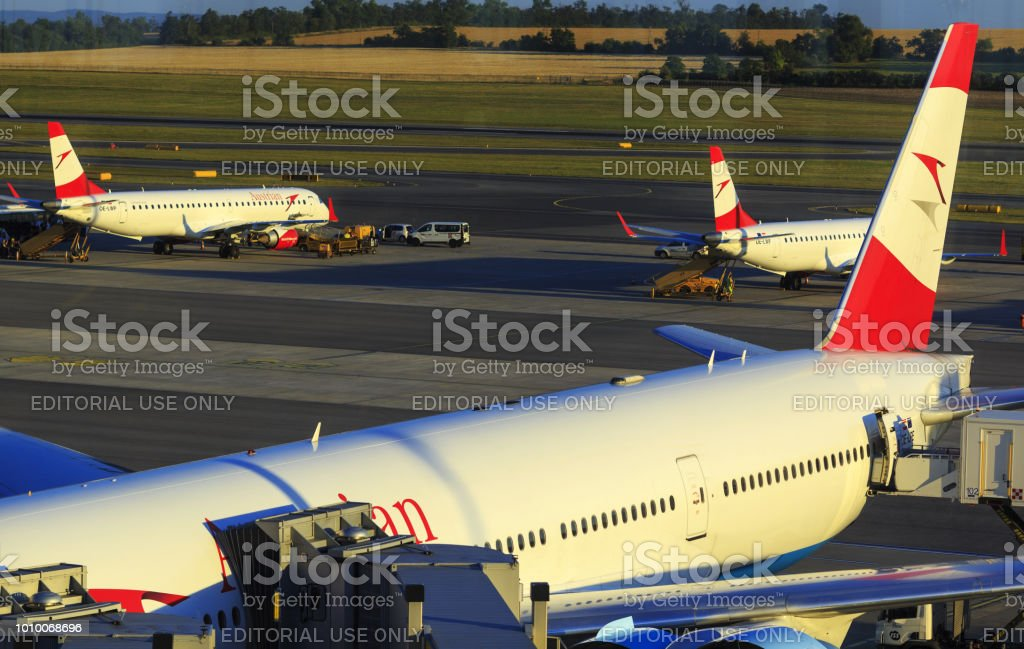 Austrian Airlines' airplanes with red logo and aircraft liveries in Vienna International Airport stock photo