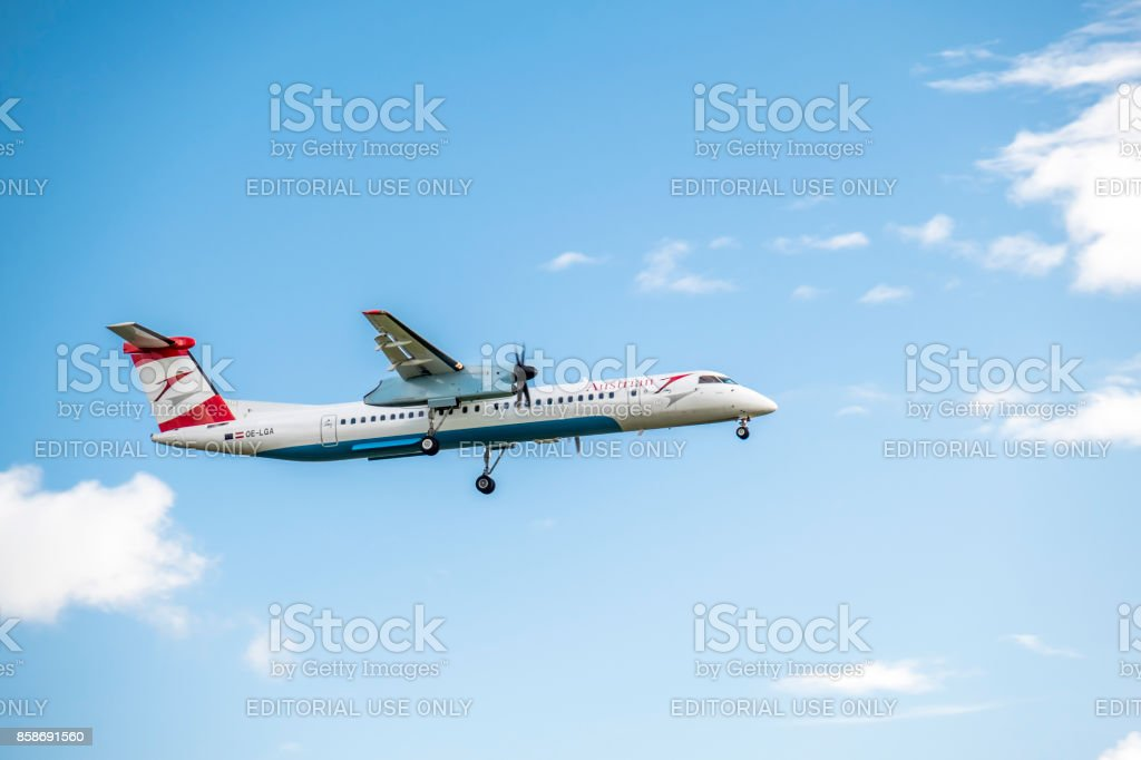 Austrian Airlines Bombadier Dash 8 Q400 landing at Dusseldorf Airport stock photo