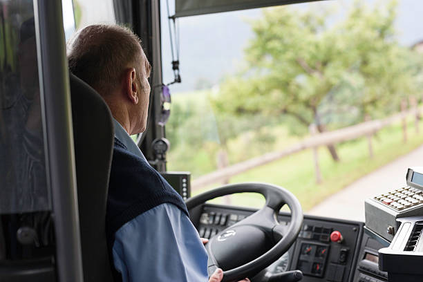 Austrian bus driver driving uphill stock photo