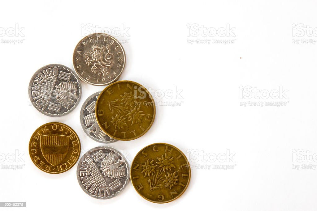 Austrian coins in a group with a single Czech coin stock photo